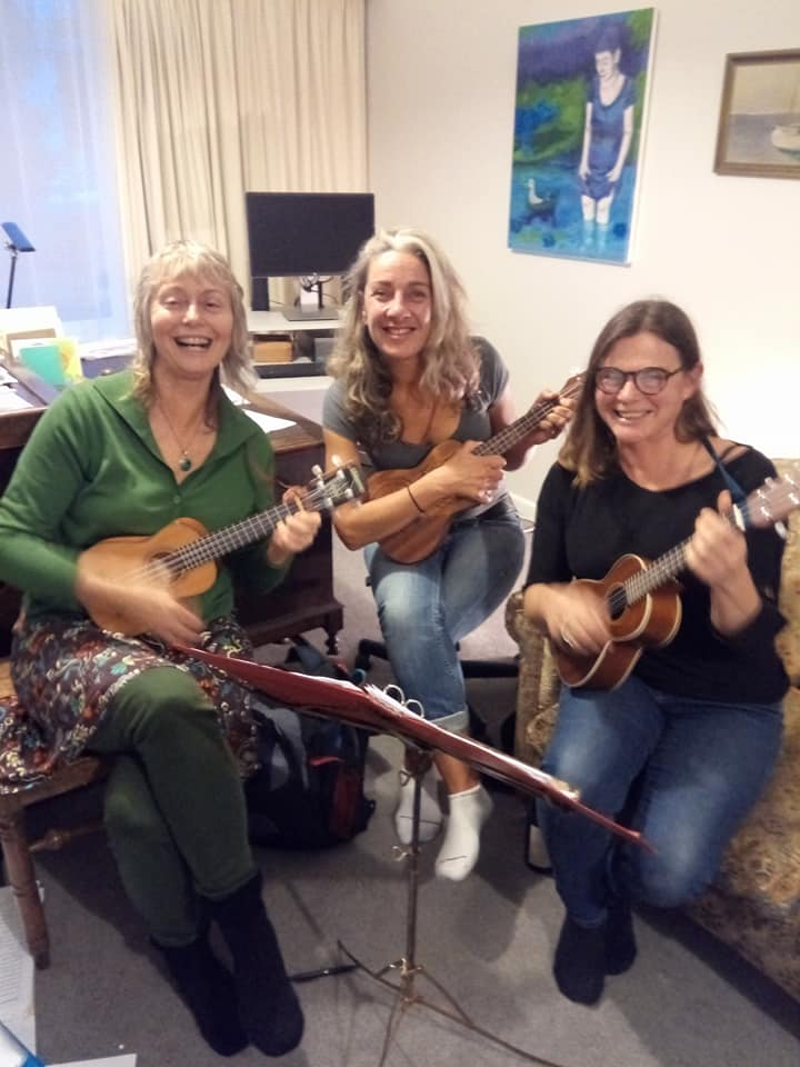 Alice Paul and Jane playing ukulele